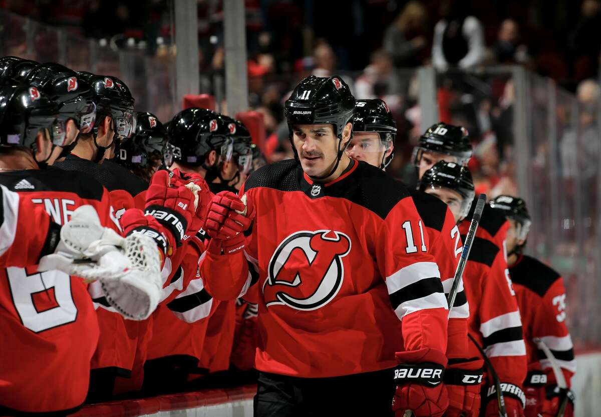 NEWARK, NJ - NOVEMBER 09: Brian Boyle #11 of the New Jersey Devils celebrates his goal with teammates on the bench in the first period against the Edmonton Oilers on November 9, 2017 at Prudential Center in Newark, New Jersey. (Photo by Elsa/Getty Images)