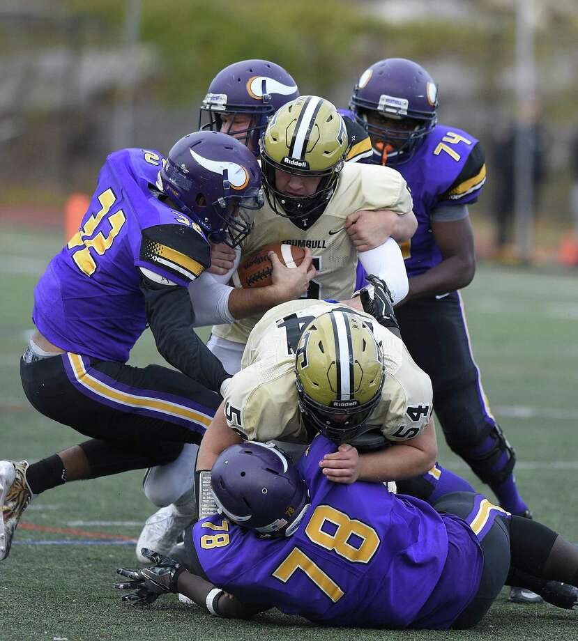 Westhill's defense swarmed all over Trumbull in a 29-21 win at Westhill High School in Stamford on Saturday. Photo: Matthew Brown / Hearst Connecticut Media / Stamford Advocate
