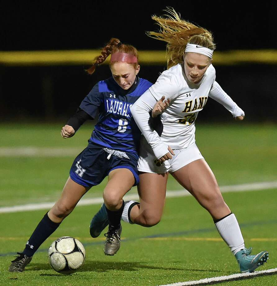 Hand senior captain Gabby Egidio controls the ball as Lauralton Hall junior Emma Koerner defends in the second round of the Class L state soccer tournament, Thursday, Nov. 9, 2017, at Strong Field at the Surf Club in Madison. Hand won, 3-0. Photo: Catherine Avalone, Hearst Connecticut Media / New Haven Register
