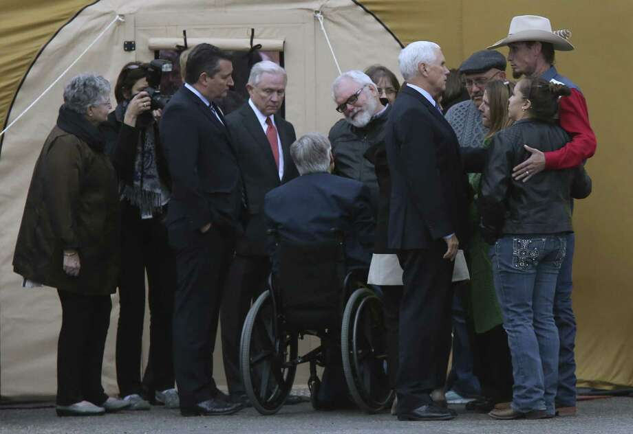 With U.S. Sen. Ted Cruz (from left) and Attorney General Jeff Sessions looking on, Gov. Greg Abbott greets Stephen Willeford in Sutherland Springs. Photo: JERRY LARA / San Antonio Express-News / © 2017 San Antonio Express-News