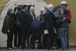 With U.S. Sen. Ted Cruz (from left) and Attorney General Jeff Sessions looking on, Gov. Greg Abbott greets Stephen Willeford in Sutherland Springs.