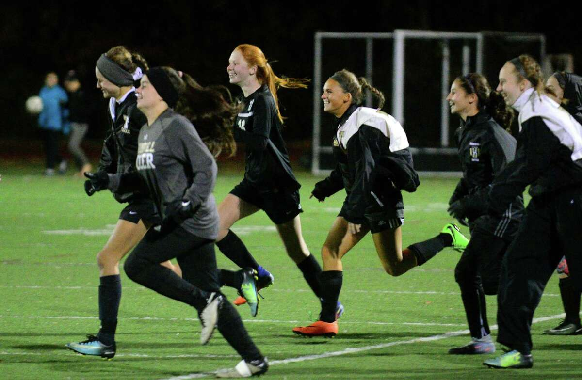 Trumbull teammates rush onto the field after defeating Fairfield Warde 3-1 in Class LL girls soccer action in Fairfield, Conn., on Thursday Nov. 9, 2017.