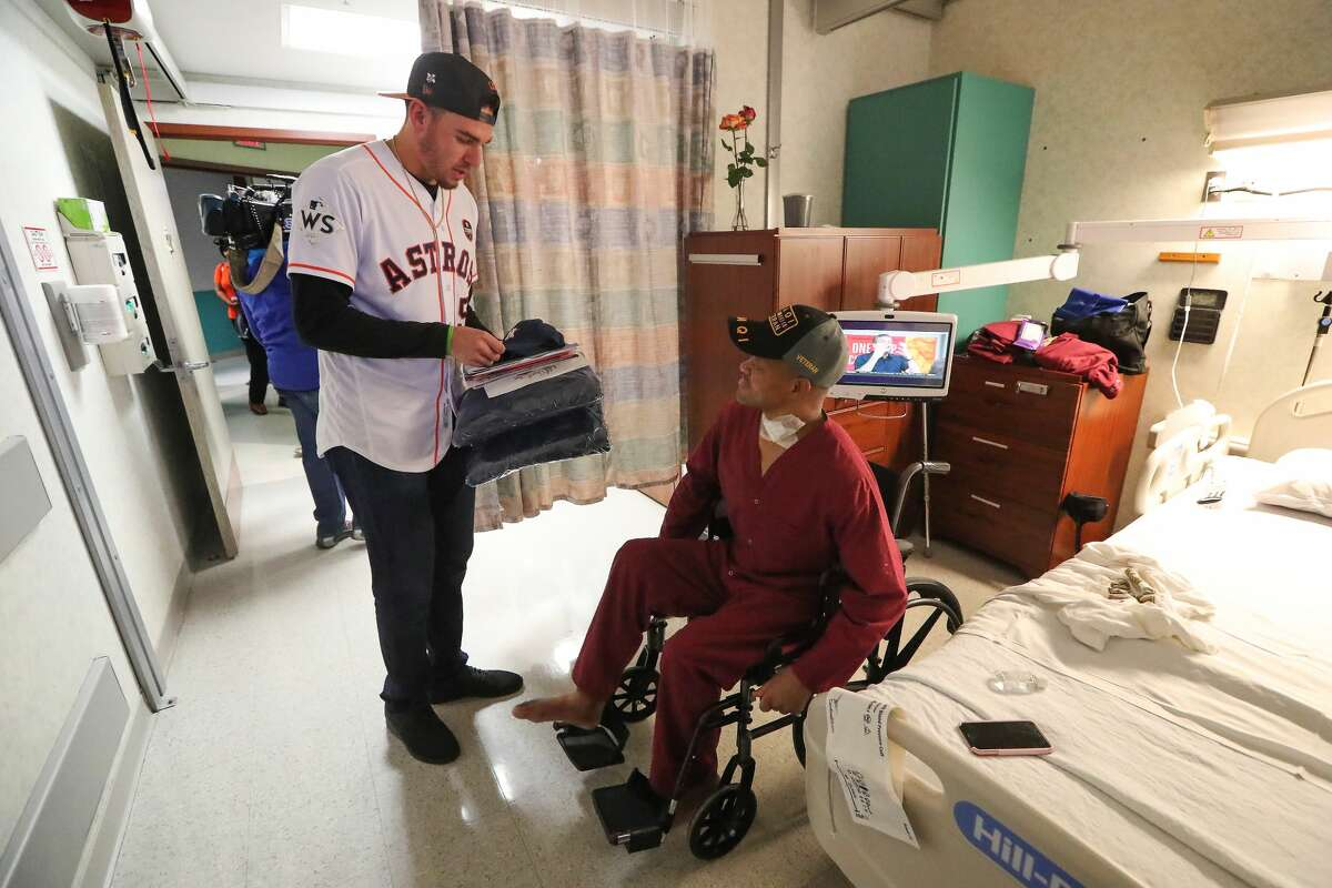 Astros pitcher and World Series Champion Joe Musgrove visited Veteran Ron West at the Michael E. DeBakey VA Medical Center Thursday, Nov. 9, 2017, in Houston. Musgrove and members from the Astros Foundation honored Veterans before Veterans Day. The Astros distributed gifts to the patients, including handmade cards from local elementary school students. ( Steve Gonzales / Houston Chronicle )