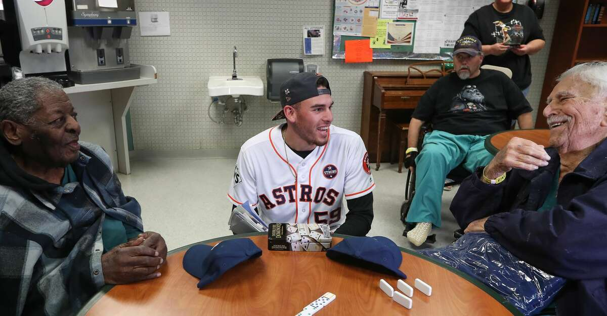 Astros pitcher and World Series Champion Joe Musgrove shares a light moment with Veterans Leland V. Roberts (left) and Jack Orlea at the Michael E. DeBakey VA Medical Center Thursday, Nov. 9, 2017, in Houston. Musgrove and members from the Astros Foundation honored Veterans before Veterans Day. The Astros distributed gifts to the patients, including handmade cards from local elementary school students. ( Steve Gonzales / Houston Chronicle )