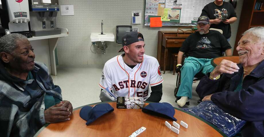 Astros pitcher and World Series Champion Joe Musgrove shares a light moment with Veterans Leland V. Roberts (left) and Jack Orlea at the Michael E. DeBakey VA Medical Center Thursday, Nov. 9, 2017, in Houston.  Musgrove and members from the Astros Foundation honored Veterans before Veterans Day. The Astros distributed gifts to the patients, including handmade cards from local elementary school students. ( Steve Gonzales / Houston Chronicle ) Photo: Steve Gonzales/Houston Chronicle