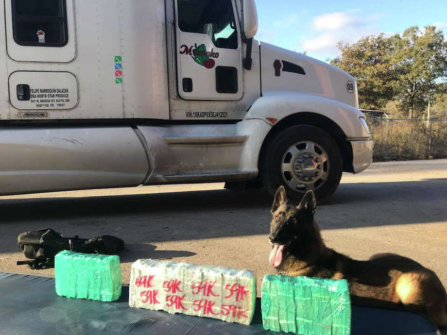 The Montgomery County Pct. 4 Constable's Office seized $120,000 in $20 bills that reportedly was stowed in a hidden compartment of a tractor-trailer driven by a Mexican national. Photo: Courtesy Photo