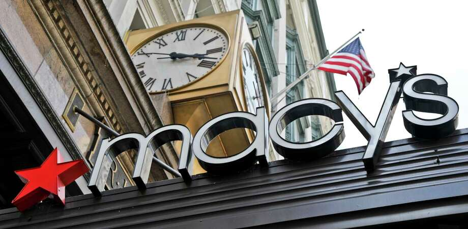 This Tuesday, May 2, 2017, photo shows corporate signage at Macy's flagship store in Manhattan, in New York. Macy's Inc. reports earnings Thursday, Nov. 9, 2017. (AP Photo/Bebeto Matthews) Photo: Bebeto Matthews, STF / Copyright 2017 The Associated Press. All rights reserved.