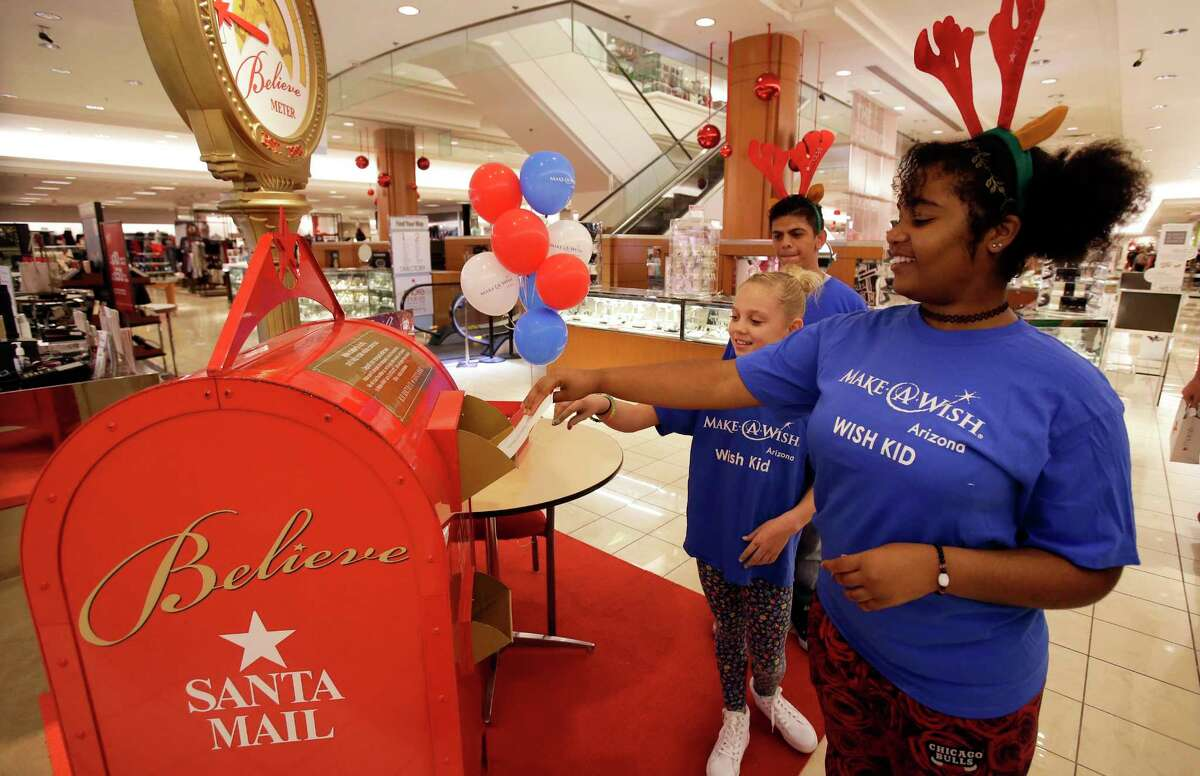 IMAGE DISTRIBUTED FOR MACY'S - Wish kids, Jazmyn, right, Irelynn, middle and Jason mail letters to Santa during the Macy's and Make-A-Wish Celebration, during the 10th Anniversary of the Believe Campaign on Wednesday, Nov. 8, 2017 in Chandler, Ariz. (Rick Scuteri/AP Images for Macy's)