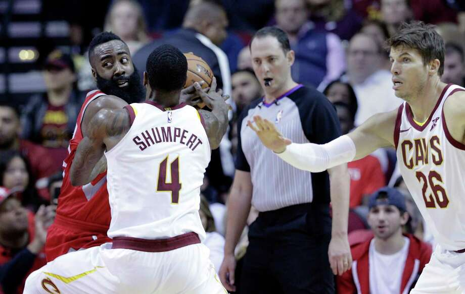 Houston Rockets guard James Harden (13) pulls the ball away from Cleveland Cavaliers guard Iman Shumpert (4) as Cavaliers guard Kyle Korver (26) watches during the first half of an NBA basketball game Friday, Nov. 9, 2017, in Houston. (AP Photo/Michael Wyke) Photo: Michael Wyke, FRE / © Associated Press 2017