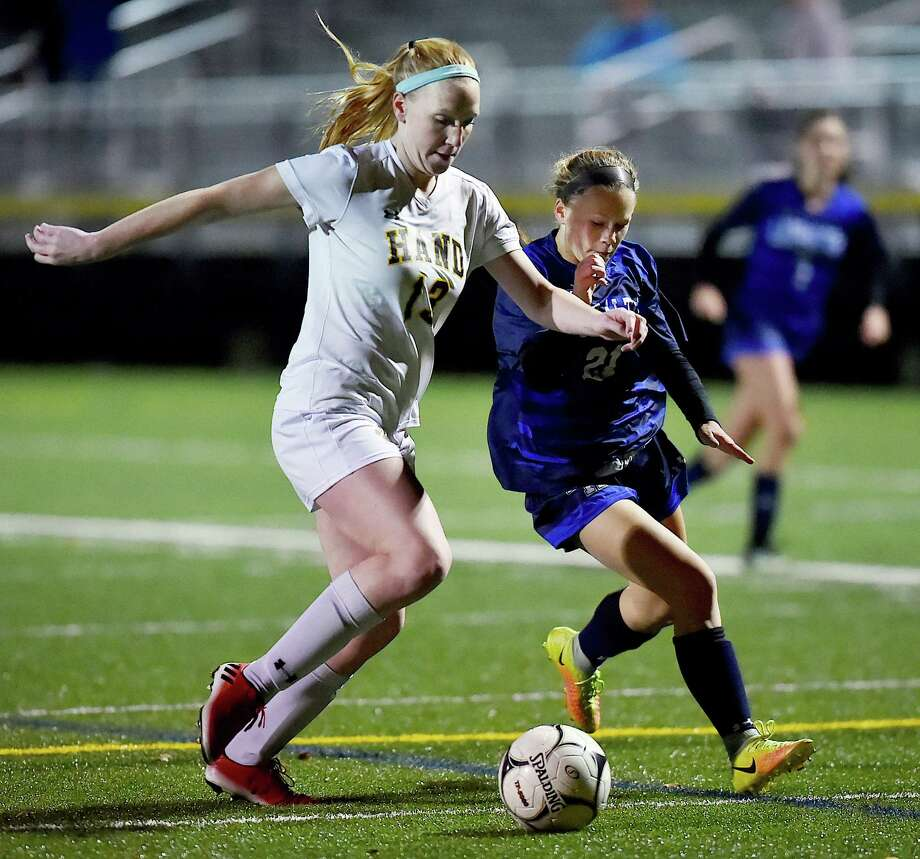Hand senior defender Heather Baughan battles Lauralton Hall junior Jacqueline Haversat in the second round of the Class L state soccer tournament, Thursday, Nov. 9, 2017, at Strong Field at the Surf Club in Madison. Hand won, 3-0. Photo: Catherine Avalone, Hearst Connecticut Media / New Haven Register