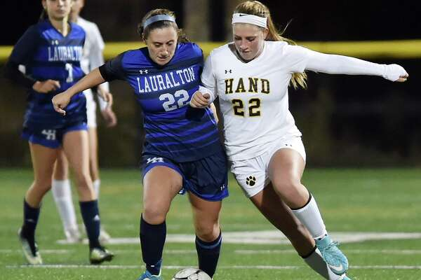 Hand senior captain Gabby Egidio battles Lauralton Hall junior Lauren Adams in the second round of the Class L state soccer tournament, Thursday, Nov. 9, 2017, at Strong Field at the Surf Club in Madison. Hand won, 3-0.