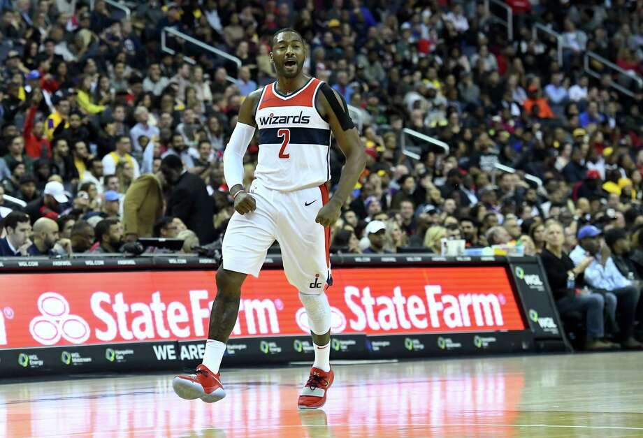 John Wall of the Wizards celebrates his play against the Lakers during the second half at Capital One Arena in Washington, District of Columbia. Wall had a game-high 23 points in helping Washington avenge an earlier loss to Los Angeles. Must credit: Washington Post photo by Katherine Frey Photo: Katherine Frey, The Washington Post / The Washington Post