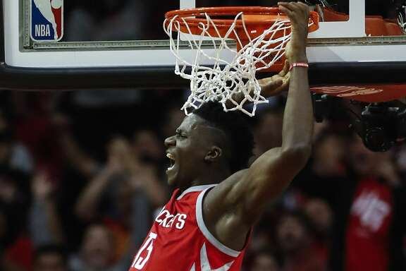 Houston Rockets center Clint Capela (15) reacts after scoring on a dunk over Cleveland Cavaliers forward LeBron James (23) during the fourth quarter of an NBA basketball game at Toyota Center on Thursday, Nov. 9, 2017, in Houston. ( Brett Coomer / Houston Chronicle )