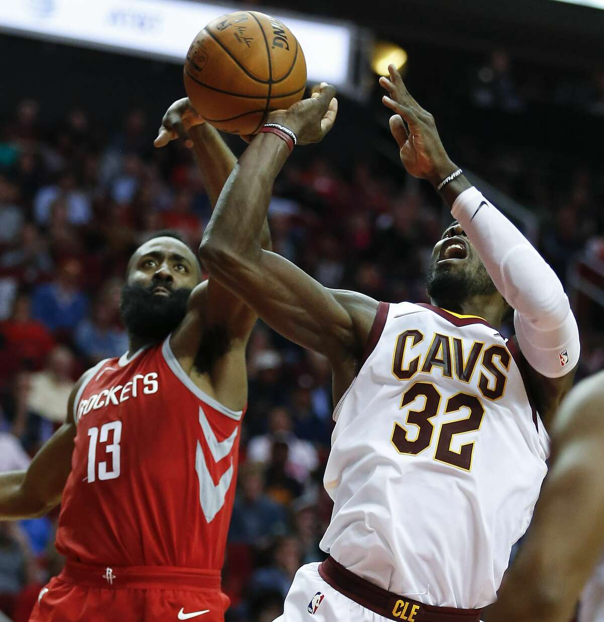 Houston Rockets guard James Harden (13) knocks the ball away from Cleveland Cavaliers forward LeBron James (23) as he takes a shot at the basket during the fourth quarter of an NBA basketball game at Toyota Center on Thursday, Nov. 9, 2017, in Houston. ( Brett Coomer / Houston Chronicle )