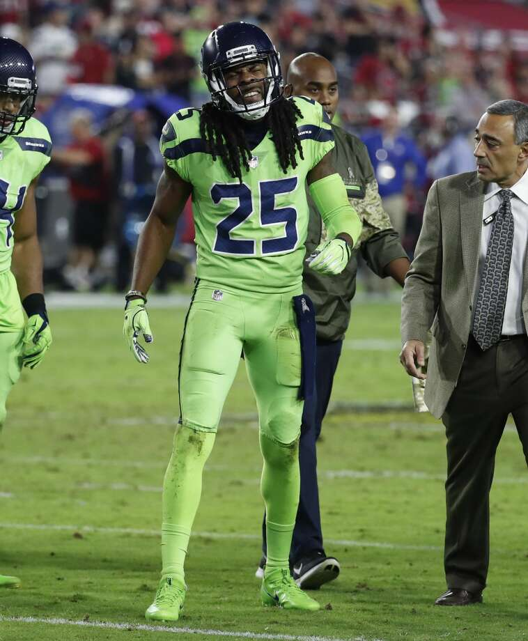 "Richard Sherman limped off the field with a foot injury in the third quarter against the Arizona Cardinals. When Griffin returned, Lane came in to fill in for Sherman, who was shown on the broadcast replays seemingly telling teammates on the sideline: ""Tore my Achilles."" Photo: Rick Scuteri/AP"