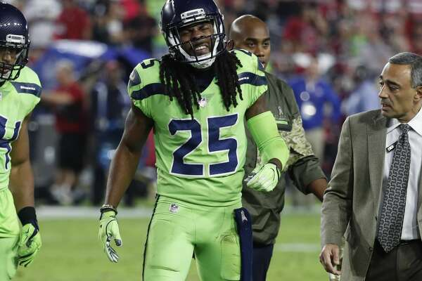 Seattle Seahawks cornerback Richard Sherman (25) walks the bench after an injury during the second half of an NFL football game against the Arizona Cardinals, Thursday, Nov. 9, 2017, in Glendale, Ariz. (AP Photo/Rick Scuteri)