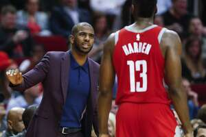 Houston Rockets guard Chris Paul, left, talks to guard James Harden (13) as he walks back upcourt during the fourth quarter of an NBA basketball game against the Cleveland Cavaliers at Toyota Center on Thursday, Nov. 9, 2017, in Houston. ( Brett Coomer / Houston Chronicle )