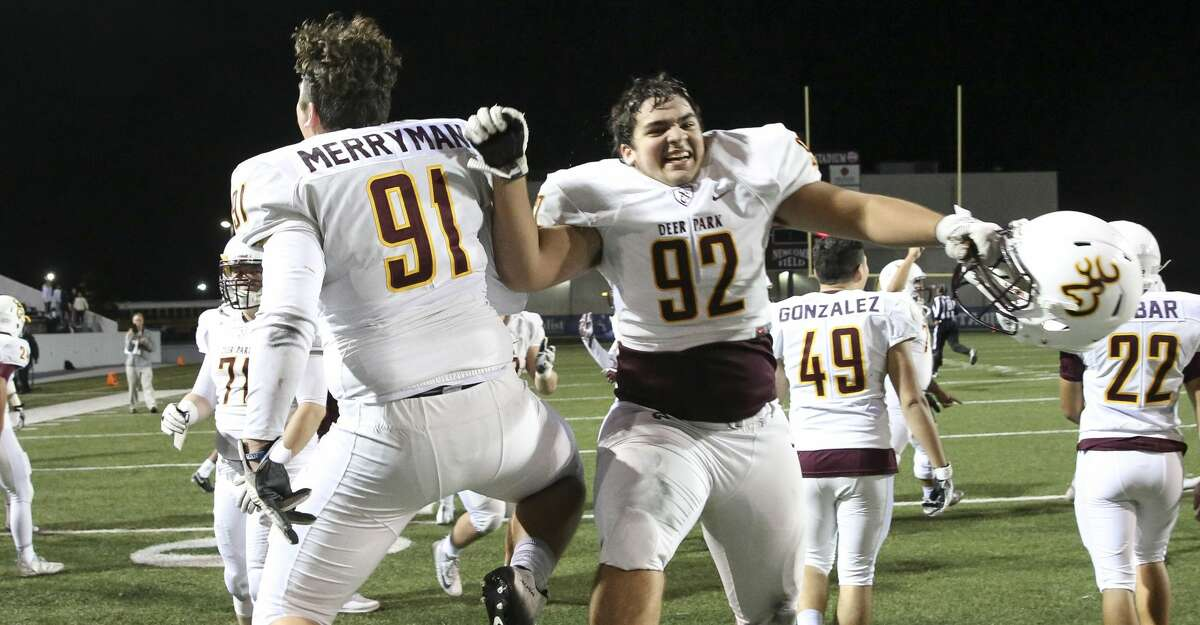 Deer Park players Blayton Merryman (91) and Kaleb Etheridge (92) celebrate after the team won the district title game at Veterans Memorial Stadium Thursday, Nov. 9, 2017, in Pasadena. Deer Park defeated Pasadena 42-24 to claim the first district championship title since 2011. ( Yi-Chin Lee / Houston Chronicle )