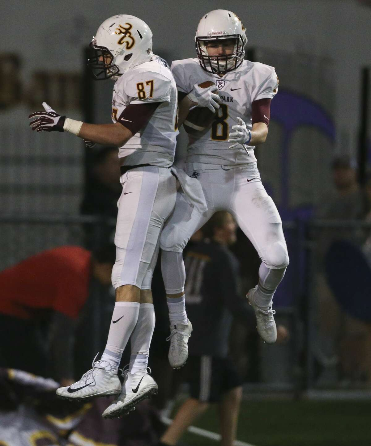 Deer Park's Dylan Heim (87) and Brandon McKissack celebrate McKissack's touch down during the second quarter of the district title game at Veterans Memorial Stadium Thursday, Nov. 9, 2017, in Pasadena. ( Yi-Chin Lee / Houston Chronicle )