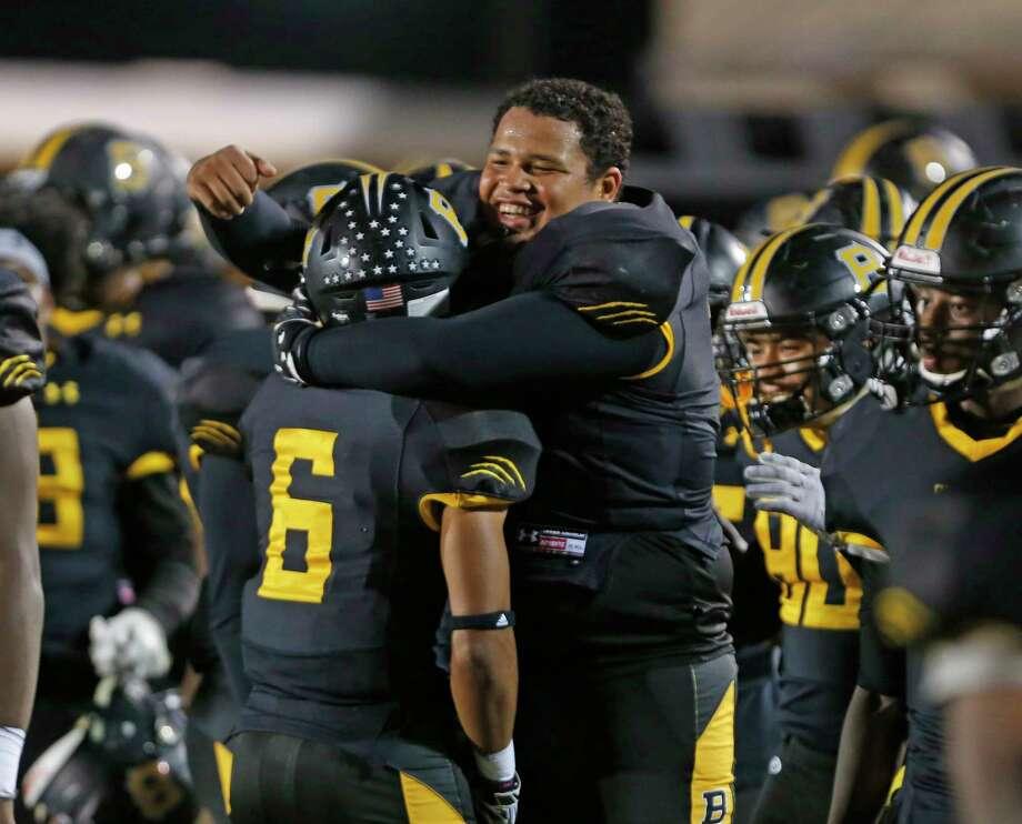 Brennans' Isaiah Walker hugs Brennans' Amani Arvelo after his first TD from the District 28-6A high school football championship game between O'Connor and Brennan on Thursday, November 9, 2017. Photo: Ron Cortes