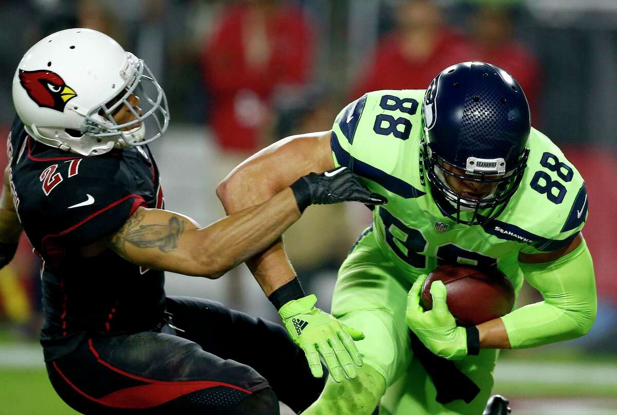 Seattle Seahawks tight end Jimmy Graham (88) catches a touchdown pass as Arizona Cardinals strong safety Tyvon Branch (27) defends during the first half of an NFL football game, Thursday, Nov. 9, 2017, in Glendale, Ariz. (AP Photo/Ross D. Franklin) ORG XMIT: AZMY110