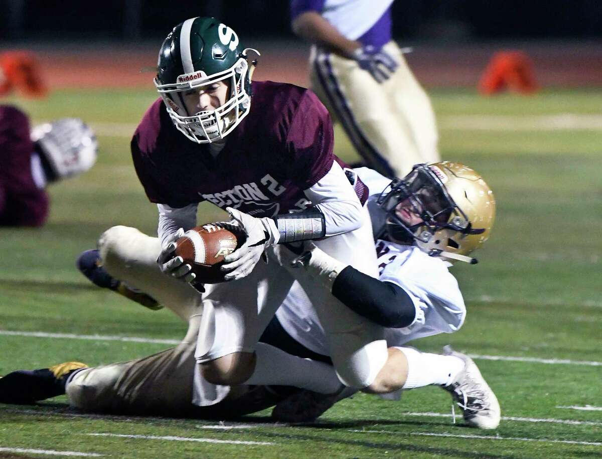 North's Cole Vincenzi of Shenendehowa ,top, is tackled by the South's Chase Irish of Christian Brothers Academy during the Section II Exceptional Seniors high school football game in Clifton Park, N.Y., Thursday, Nov. 9, 2017. (Hans Pennink / Special to the Times Union) ORG XMIT: HP101