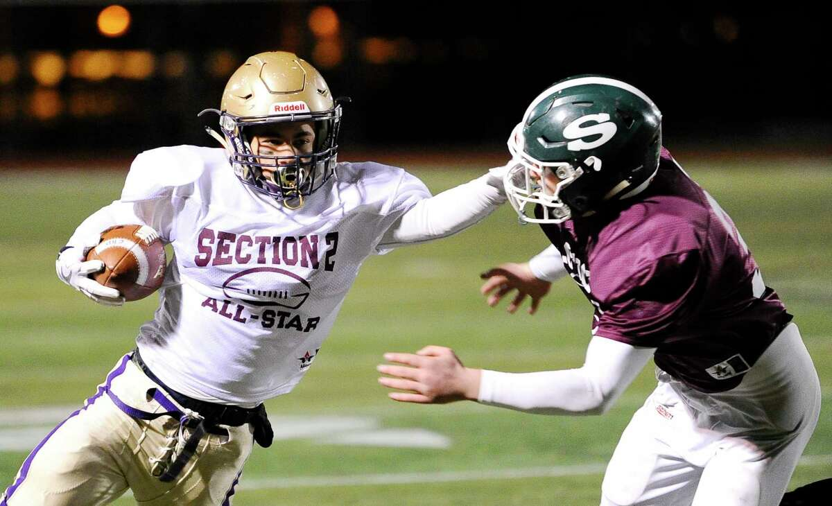 South's Dylan Gotay ,left, of Christian Brothers Academy move the ball past North's Jacob McGrail of Shenendehowa during the Section II Exceptional Seniors high school football game in Clifton Park, N.Y., Thursday, Nov. 9, 2017. (Hans Pennink / Special to the Times Union) ORG XMIT: HP102