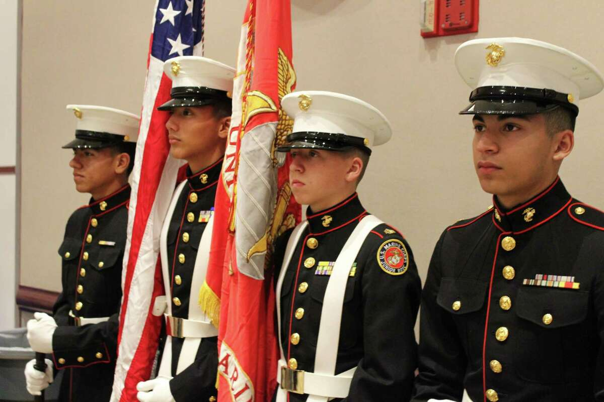 Atascocita High School Marine Corp Junior ROTC color guard members  present the colors during the Tribute to Veterans event at the Humble Civic Center on Nov. 8.