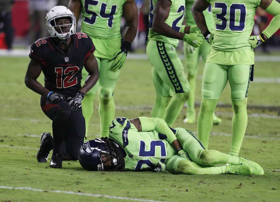 Seattle Seahawks cornerback Richard Sherman (25) lies on the turf after tackling Arizona Cardinals wide receiver John Brown (12) during the second half of an NFL football game, Thursday, Nov. 9, 2017, in Glendale, Ariz. (AP Photo/Rick Scuteri) Photo: Rick Scuteri/AP