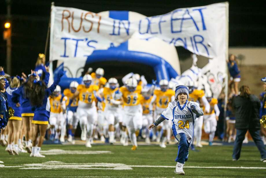 Ten-year-old Reid Smith leads the Clemens Buffaloes onto the field at the start of their District 27-6A high school football game with Steele at Lehnhoff Stadium on Thursday, Nov. 9, 2017.  MARVIN PFEIFFER/mpfeiffer@express-news.net Photo: Marvin Pfeiffer, Staff / San Antonio Express-News / Express-News 2017