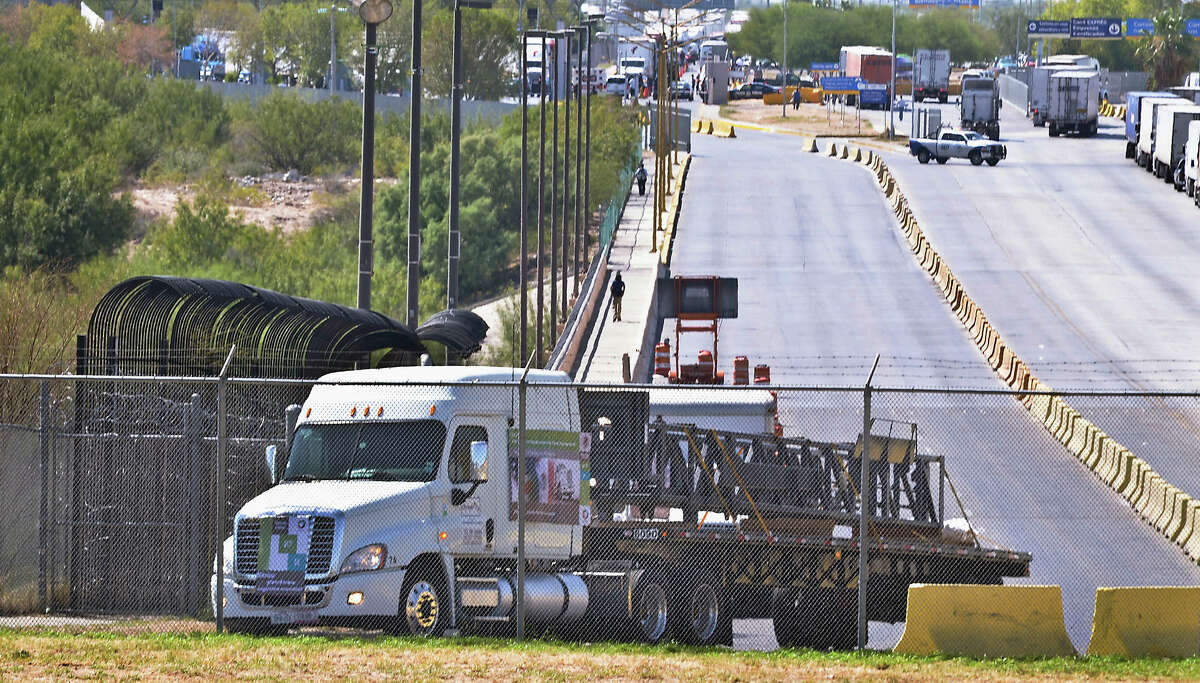 The first commercial truck from Mexico that will travel to Garland, Texas from Apocada, Nuevo Leon, Mexico, crosses the World Trade Bridge from Nuevo Laredo, Tamaulipas, Mexico into Laredo, Texas, Friday, Oct. 21, 2011. For the first time under the North American Free Trade Agreement, a Mexican tractor-trailer has crossed the border into the U.S. on its way into the country's interior. The NAFTA trucking program was stalled for years by concerns that it would put highway safety and American jobs at risk. But the commercial truck hauling a steel drilling structure entered the United States on Friday afternoon, nearly two decades after passage of the agreement, which was supposed to improve cargo transportation between the two countries. (AP Photo/The Laredo Morning Times, Ricardo Santos)