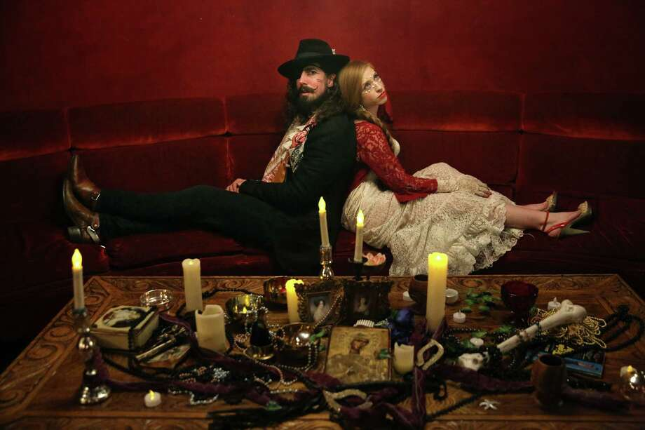Tennessee Pink, aka Nicholas Adamski, and The Madame aka Stephanie Berger, who organized the Poetry Brothel Masquerade event, pose for a portrait, Thursday night, Nov. 9, 2017, at Rendezvous. The New York based group presented an immersive poetry event that included music, burlesque, private poetry, palm and tarot readings. Photo: GENNA MARTIN, SEATTLEPI / SEATTLEPI.COM