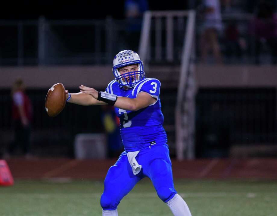 Klein QB Greyson Lembcke (3) looks to throw downfield. Klein will face the Spring Lions next week in the bi-district round of the playoffs. Photo: Juan DeLeon / Houston Chronicle