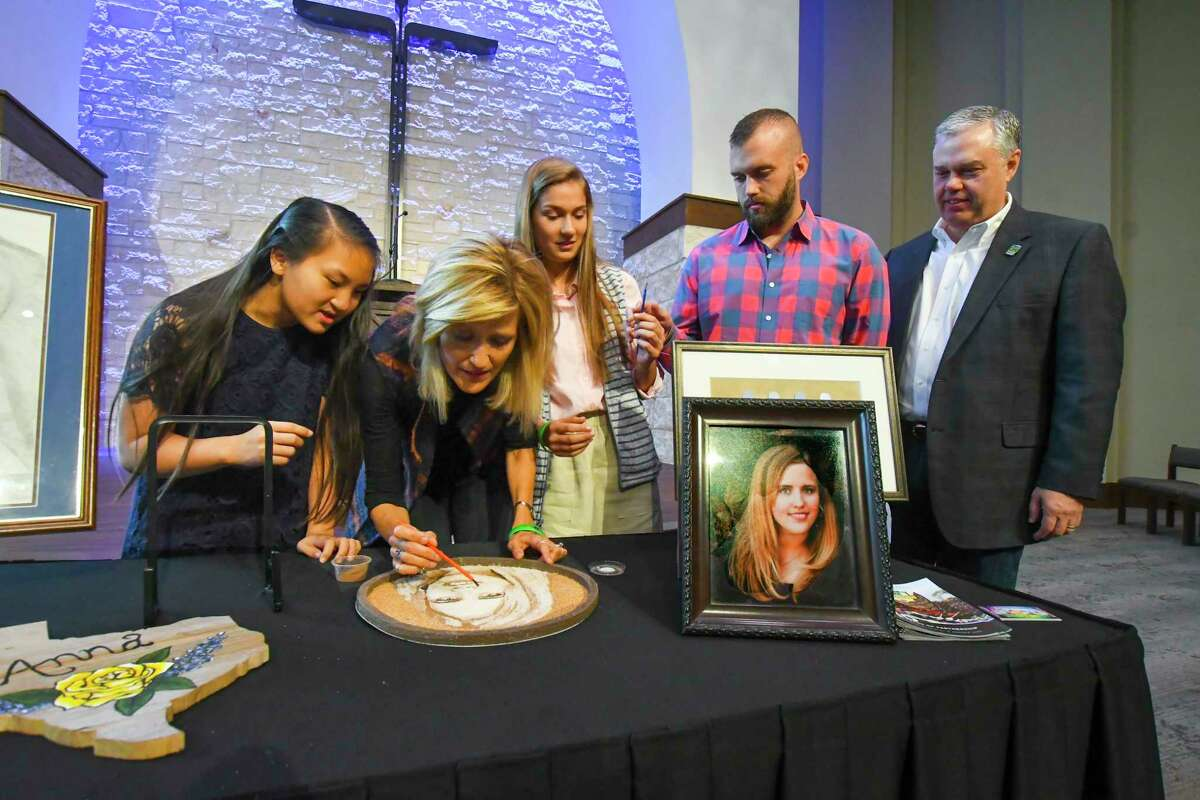 """Mary Klein and family help to finish the """"floragraph""""�"""