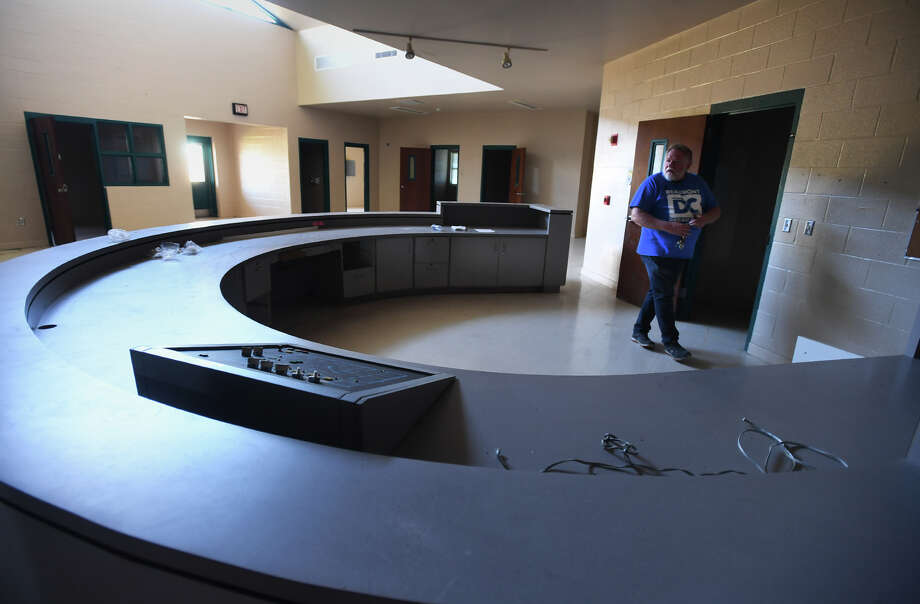 Mike Conner walks through the Infirmary at the Al Price Juvenile Correctional Facility on Thursday. Conner is renting the center with plans to convert it into a large social center and education facility.   Photo taken Thursday, November 09, 2017 Guiseppe Barranco/The Enterprise Photo: Guiseppe Barranco, Photo Editor / Guiseppe Barranco ©