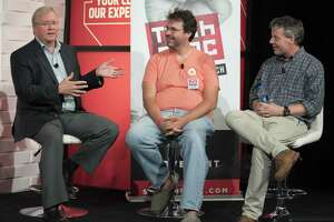 Graham Weston (from left), Dirk Elmendorf, and Lew Moorman take part in a panel discussion during the annual Tech Bloc rally, Thursday, Nov. 9, 2017, at Rackspace in San Antonio.