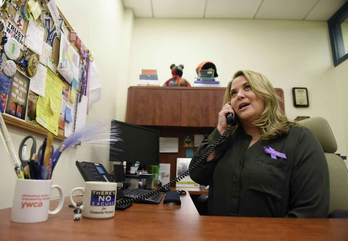 YWCA Greenwich Director of Domestic Abuse Services Meredith Gold poses in her office at the YWCA in Greenwich, Conn. Wednesday, Oct. 25, 2017. YWCA Greenwich offers many domestic abuse services, including a 24-hour hotline, immediate assistance, counseling services, emergency shelter, safety planning, children's services, court services, and resources for immigrants.