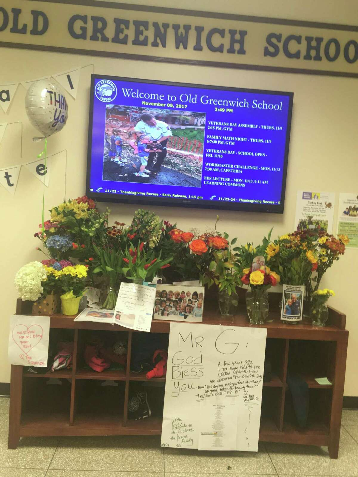 A memorial made of flowers and cards has been erected at Old Greenwich School in honor of a teacher there, Frank Gasparino, who died Wednesday.