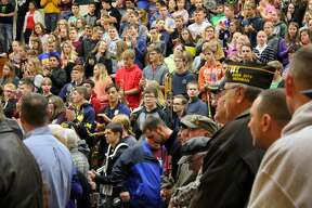 Cass City Junior/Senior High School students paid tribute to local veterans Friday morning. The tribute included a flag-raising ceremony, performances by the Cass City High School Band, speeches by veterans and presentations.