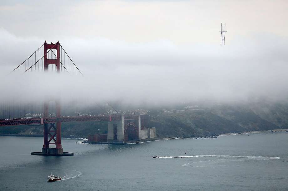 Fog surrounds the Golden Gate bridge on Friday, August 4, 2017, in Marin County, Calif. Light rain ralling in the Bay Area Friday should clear out by the evening, forecasters said. Photo: Liz Hafalia, The Chronicle