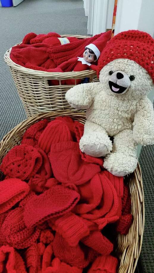 The American Heart Association seeks donations of knitted or crocheted infant-sized red hats for its annual Little Hats, Big Hearts program, which aims to raise awareness for congenital heart defects. Photo: Contributed Photo