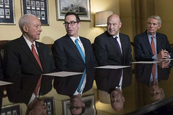 From left, Senate Finance Committee Chairman Orrin Hatch, R-Utah, Treasury Secretary Steven Mnuchin, President Donald Trump's top economic adviser Gary Cohn, and Sen. Rob Portman, R-Ohio, make statements to reporters as work gets underway on the Senate's version of the GOP tax reform bill, on Capitol Hill in Washington, Thursday, Nov. 9, 2017. (AP Photo/J. Scott Applewhite)