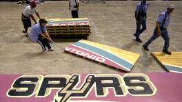 The Alamodome conversion crew works Thursday afternoon May 15, 2002 to pull the Spurs' basketball floor out of the Alamodome for the last time. The floor will be sold and used elsewhere.