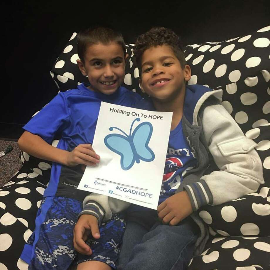 "These two children met through Rays of Hope support groups and wear blue for ""Blue Day."" Photo: Courtesy Photo"