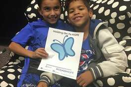 "These two children met through Rays of Hope support groups and wear blue for ""Blue Day."""