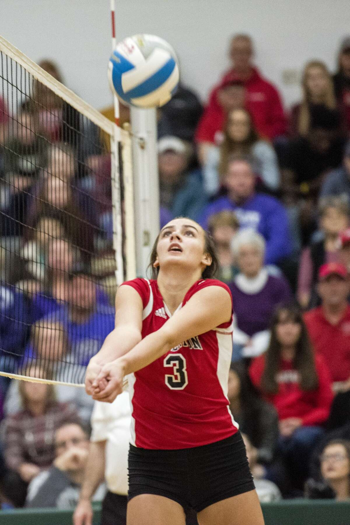 Beaverton senior Reiss Faber bumps the ball during the Class C regional finals against the Shelby Tigers on Thursday, Nov. 9, 2017 at Pinconning High School. The Tigers won the match in three sets. (Danielle McGrew Tenbusch/for the Daily News)