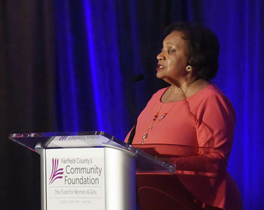 FCCF President and CEO Juanita James speaks during the Fairfield County's Community Foundation's Fund for Women & Girls Annual Luncheon at the Hyatt Regency in Greenwich, Conn. Thursday, April 20, 2017. Women who benefited from the Family Economic Security Program spoke praises and Andrea Jung, the first female CEO at Avon, presented the keynote to a crowd of more than 700. Photo: Tyler Sizemore / Hearst Connecticut Media / Greenwich Time