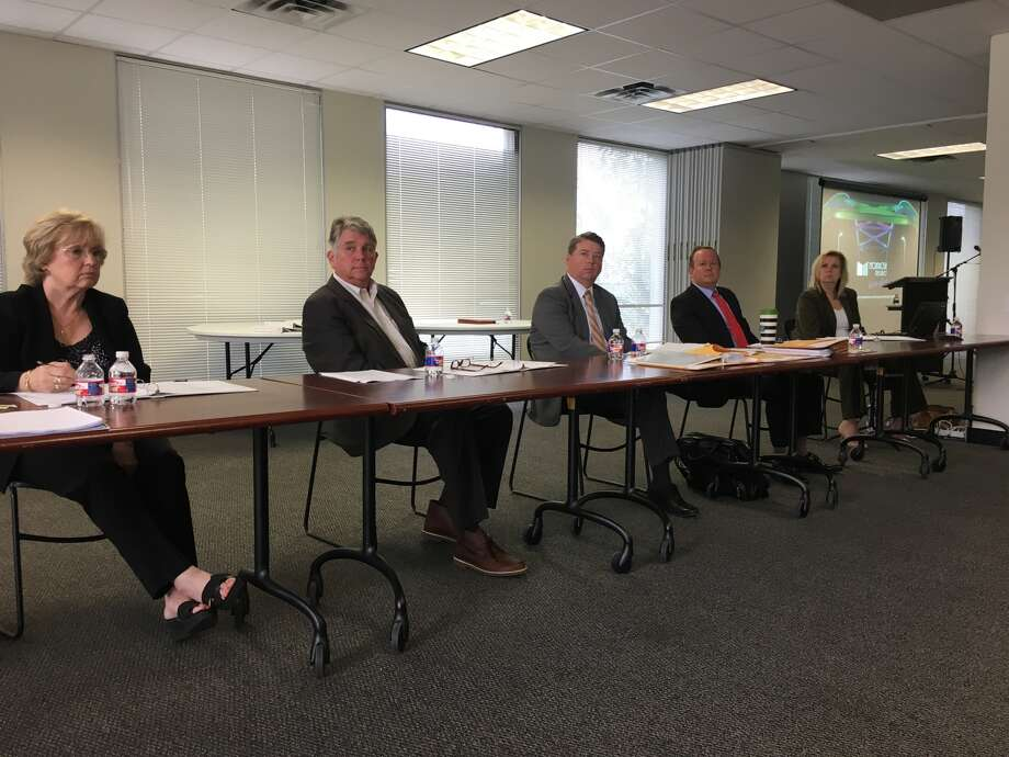 Officials from the Montrose Management District at a public hearing Nov. 3. (from left) Pat Hall of Equi-Tax, assessor/collector of the district; Ben Brewer, district executive director; Richard Whiteley of Bracewell, chief hearing examiner; Clark Stockton Lord of Bracewell, attorney for the district; court reporter