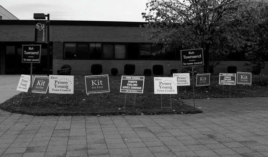 Signs outside New Canaan High School on Nov. 7 Photo: Erin Kayata / Hearst Connecticut Media / New Canaan News