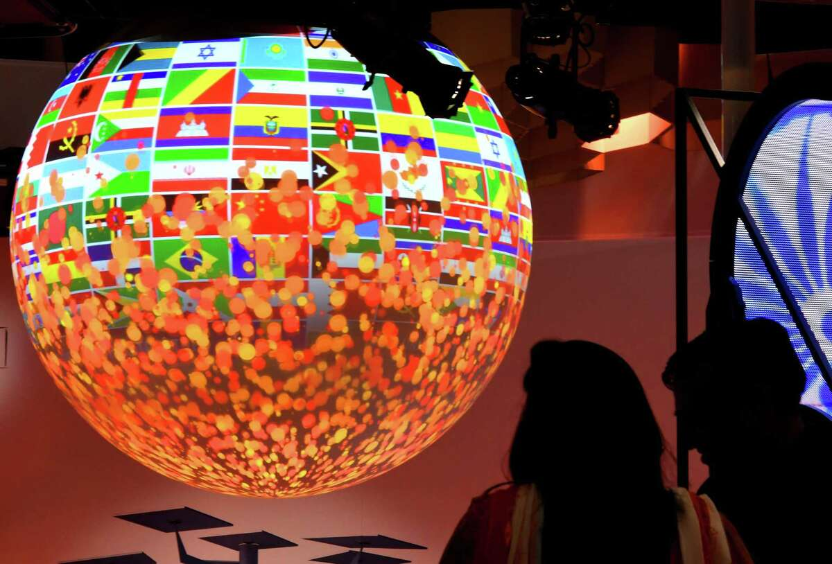 Visitors look at a sphere displayed at the pavillion of India on November 8, 2017 during the COP23 United Nations Climate Change Conference in Bonn, Germany. / AFP PHOTO / PATRIK STOLLARZPATRIK STOLLARZ/AFP/Getty Images ORG XMIT: 27